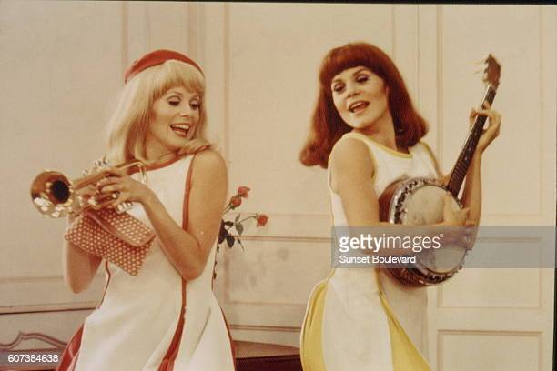 French actresses and sisters Catherine Deneuve and Françoise Dorleac on the set of Les demoiselles de Rochefort written and directed by Jacques Demy
