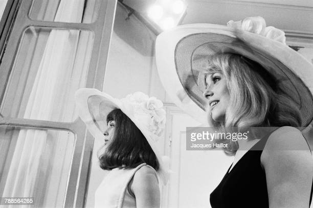 French actresses and sisters Francoise Dorleac and Catherine Deneuve on the set of Les Demoiselles de Rochefort directed by Jacques Demy and Agnes...