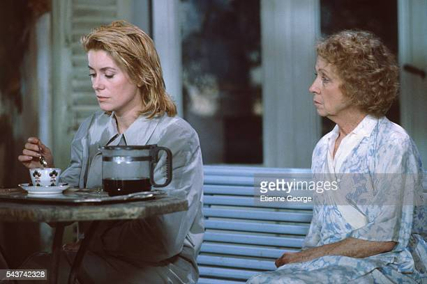 French actresses Catherine Deneuve and Danielle Darrieux on the set of the film Le Lieu du crime directed by André Téchiné