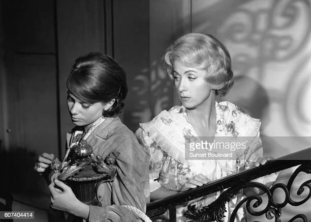 French actresses Catherine Deneuve and Danielle Darrieux on the set of L'homme à femmes based on the novel by British Hugh Wheeler and directed by...