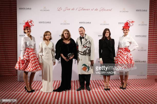 French actresses Catherine Deneuve Isabelle Huppert and Deneuve's daughter Chiara Mastroianni pose for pictures with Belgian artist and designer...