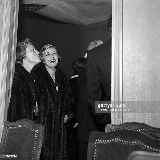 French Actresses Claudette Colbert and Suzy Delair In France In 1950French actresses Claudette Colbert and Suzy Delair at a party in the fifties