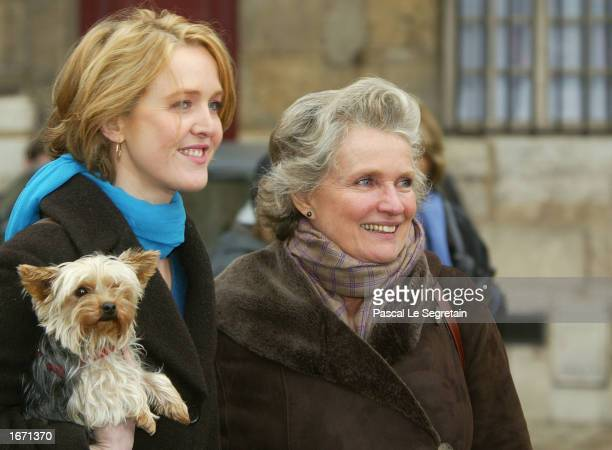 French actresses Fanny Cottencon and Marie Christine Barrault attend the funeral services for French actor Daniel Gelin December 4 2002 in Paris...