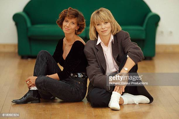 French actresses Fiona Gelin and Mireille Darc on the set of singer and songwriter Michel Sardou's music video for his song 'MarieJeanne'