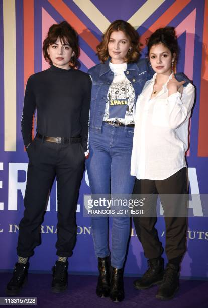 French actresses Laetitia Casta Noee Abita and Alba Gaia Bellugi pose during a photocall for the series Une Ile at the Series Mania Festival at the...