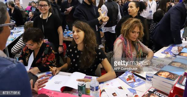 French actresses Nicole Ferroni and Clementine Celarie sign their book during the 36th edition of the 'Foire du Livre de Brive' book fair on November...