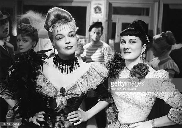 French actresses Simone Signoret and Dominique Davray on the set of Casque d'Or written and directed by Jacques Becker