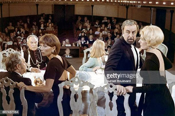 French actresses Stephane Audran and Delphine Seyrig with Spanish actor Fernando Rey on the set of Le Charme Discret de la Bourgeoisie directed by...
