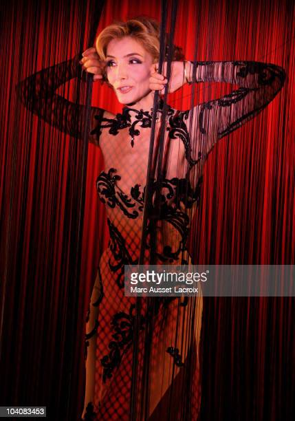 French actress/singer Clotilde Courau performs during her act 'Les nuits d'une demoiselle' alongside dancers of the Parisian cabaret at Le Crazy...