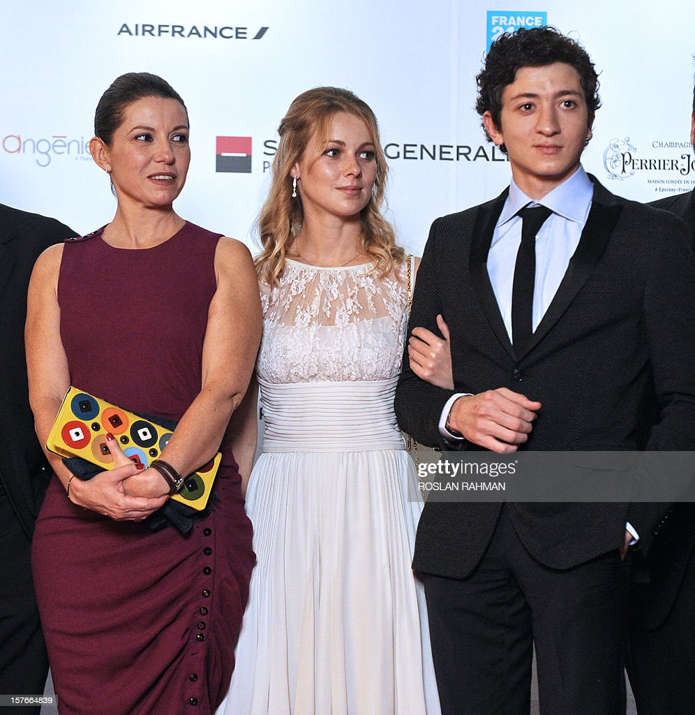 French actrors Fleur-Lise Heuet (C) and Jules Sitruk (R) and French ...