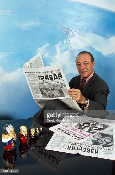 French advertising mogul Jacques Seguela holds a copy of the Pravda newspaper