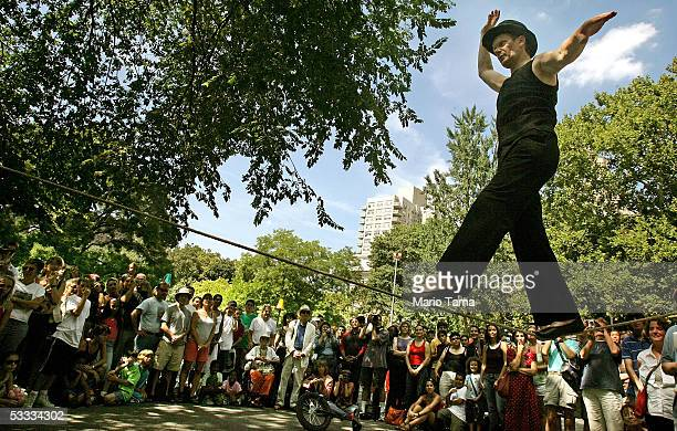 French aerialist Philippe Petit performs for a crowd in Washington Square Park August 6 2005 in New York City Petit walked on a tightrope between the...