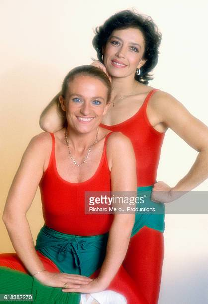 French aerobics instructors Veronique and Davina pose in their workout clothing They host the aerobics TV show Gym Tonic