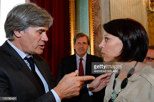 French Agriculture Minister Stephane Le Foll speaks with his Italian counterpart Nunzia De Girolamo after their meeting focusing on the reform of the...