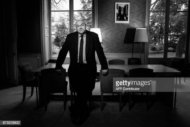 French Agriculture Minister Stephane Travert poses during a photo session in his office in Paris on November 8 2017 / AFP PHOTO / JOEL SAGET