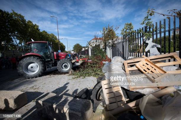 French Agriculture unionist in a tractor spills fruits and trash in front of the entrance of the prefecture of Vaucluse, to protest against the end...