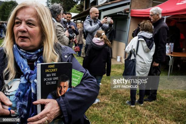 French Aime Jacquet , former coach of French national football team 1998 and world champion poses with inhabitants on May 10, 2018 in...
