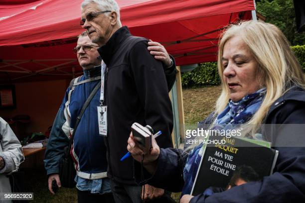 TOPSHOT French Aime Jacquet former coach of French national football team 1998 and world champion poses with inhabitants on May 10 2018 in...