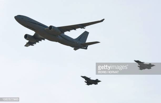 French air force army new Airbus A330 Multi Role Tanker Transport phoenix plane and its two rafale jets escort fly over the Istres military base...