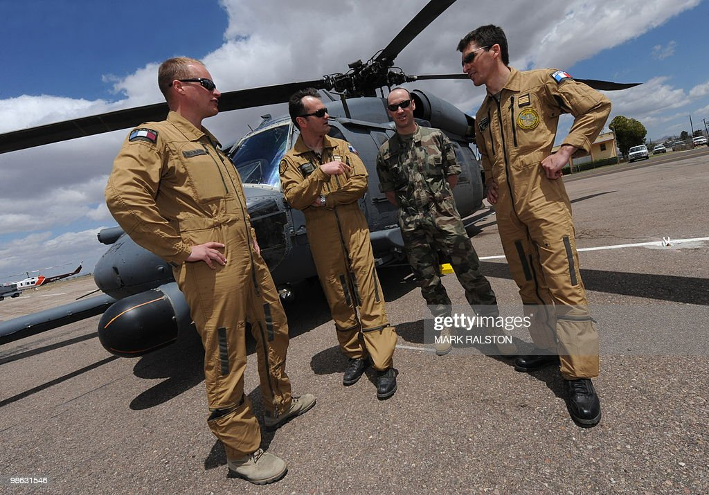 French Air Force observors (L-R) Lt Delbart, Lt Fabrice Albrecht, Commando F. Romaire and Pilot Olivier Mainy stand in front of a HH-60 Pave Hawk helicopter before a rescue operation during Exercise Angel Thunder, near the town of Bisbee in Arizona's Sonoran Desert on April 21, 2010. Exercise Angel Thunder simulates personnel recovery missions behind enemy lines and is the largest Department of Defense personnel recovery exercise to date. International observors from from Australia, Brazil, Canada, Chile, Colombia, Denmark, France, Germany, Netherlands, and United Kingdom took part in the event.. AFP PHOTO/Mark RALSTON