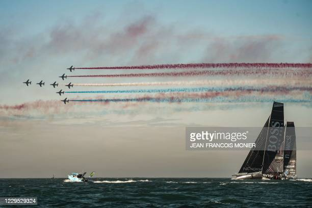 """French air force's aerobatics demonstration unit """"Patrouille de France"""" flies over Britain skipper Alex Thomson's boat Hugo Boss at the start of the..."""