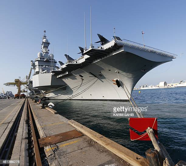 French aircraft carrier Charles de Gaulle is moored in Port Zayed in the Emirati capital Abu Dhabi on January 8 2014 before taking part in a training...