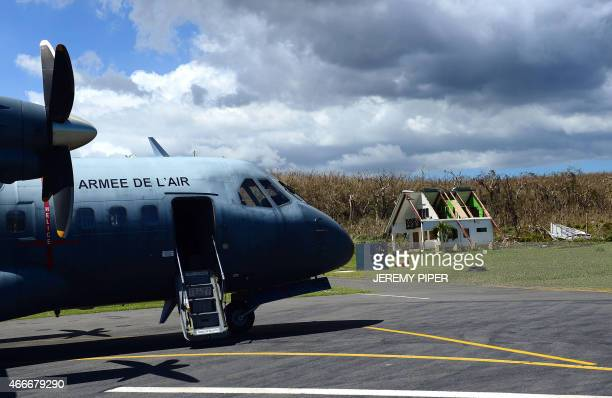 A French aircraft from New Caledonia arrives with supplies for those affected by Cyclone Pam at the airport on the Vanuatu island of Tanna on March...