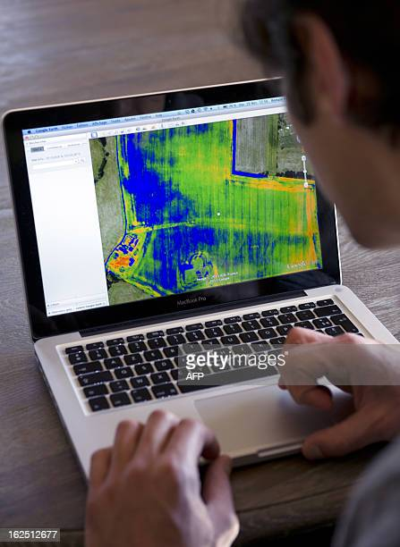 French Airinov's commercial director Romain Faroux studies on a computer screen a picture taken by a drone made by the startup company specialised in...