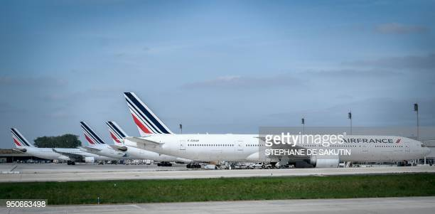 French airliner company Air France's planes are parked on April 24 2018 on the tarmac of the RoissyCharles de Gaulle airport near Paris as company...
