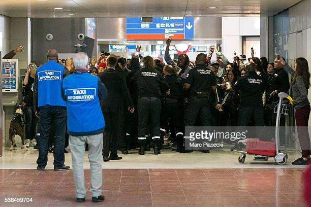 French airport security try to block fans as Kpop singers Amber Josephine Liu aka Amber and Park Seon Yeong aka Luna of 'f' arrive at CharlesdeGaulle...