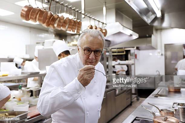 French Alain Ducasse cooks in the kitchen of his 'Louis XV' restaurant in the Hotel de Paris in Monaco which will be celebrating its 25th anniversary...