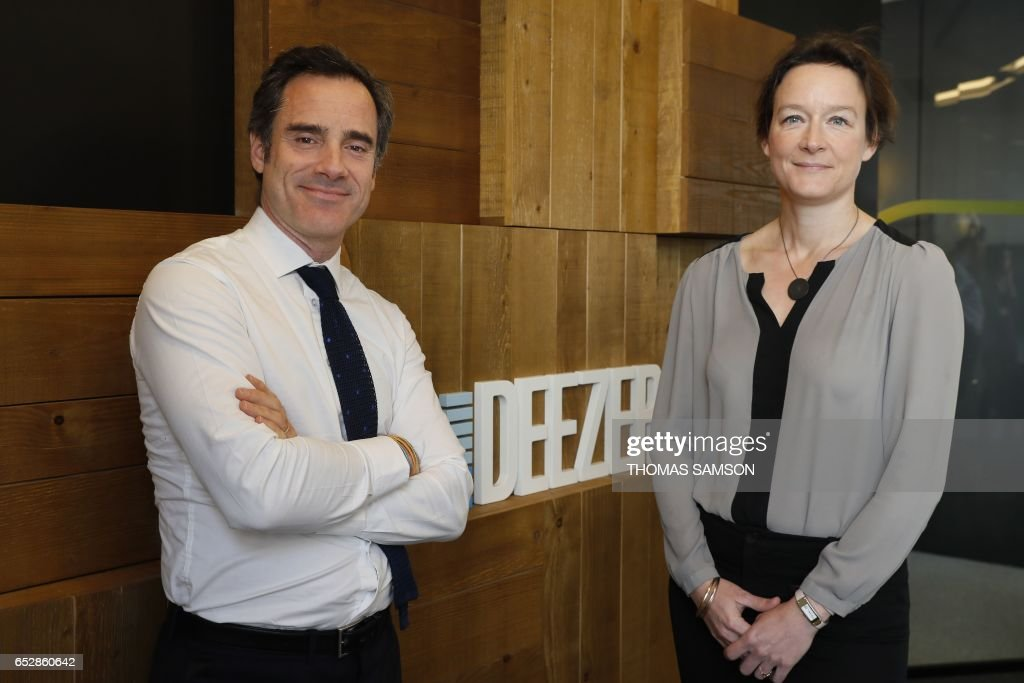 French Alexis de Gemini, CEO of Deezer France, and French Coralie Piton, Fnac-Darty strategy director, pose in Paris, on March 13, 2017. Fnac and Deezer have entered into an alliance that aims to give a boost to recruiting subscribers to the French leader of music streaming. /