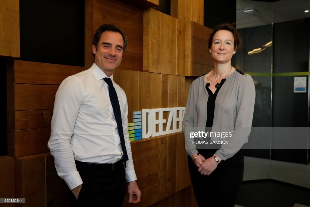 French Alexis de Gemini, CEO of Deezer France, and French Coralie Piton, Fnac-Darty strategy director, pose in Paris, on March 13, 2017. Fnac and Deezer have entered into an alliance that aims to g...