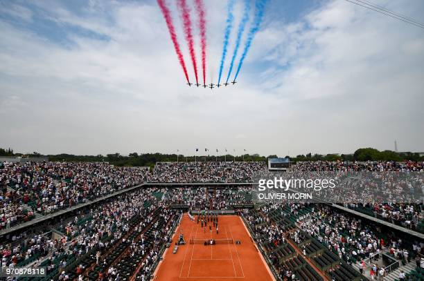 French AlphaJet aircraft of the Patrouille de France fly over the Philippe Chatrier court for the 100th anniversary of the disappearance of Roland...