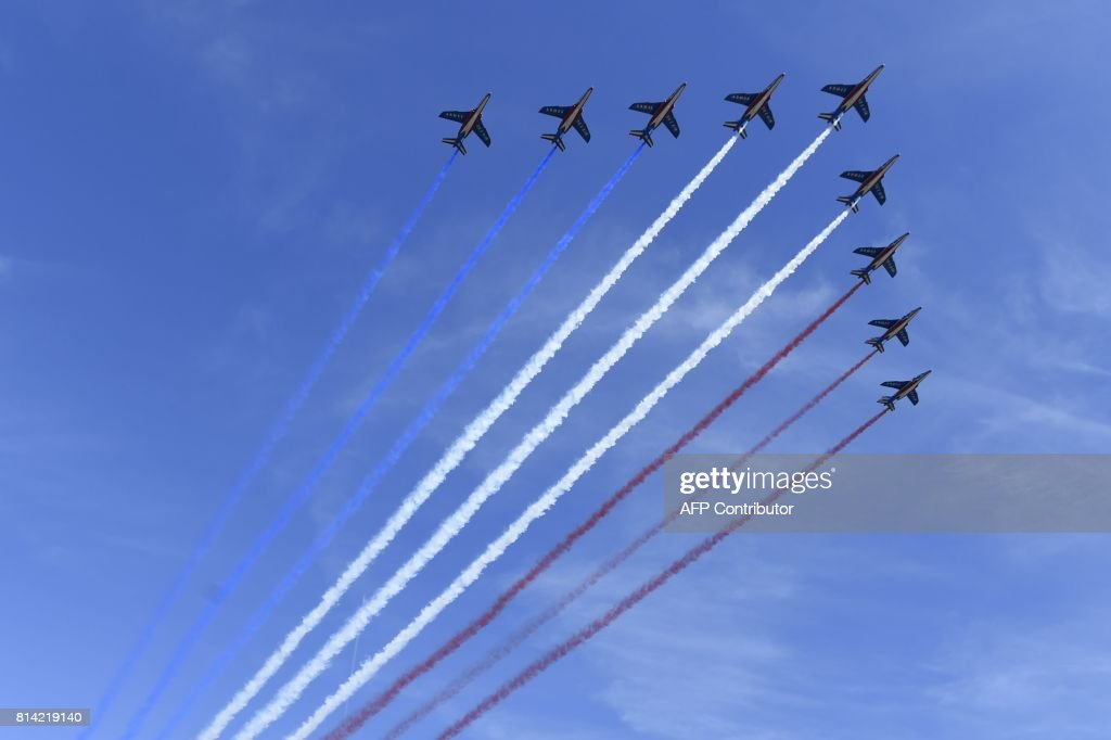 French AlphaJet of the Patrouille de France fly over Paris during the annual Bastille Day military parade on the Champs-Elysees avenue in Paris on July 14, 2017. The parade on Paris's Champs-Elysees will commemorate the centenary of the US entering WWI and will feature horses, helicopters, planes and troops. /