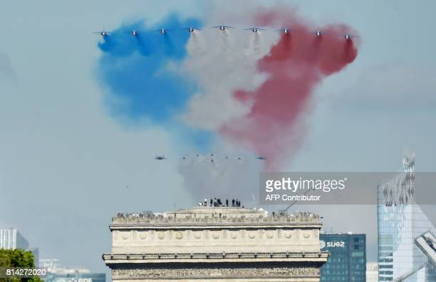 French AlphaJet of the Patrouille de France fly over the Arc de Triomphe during the annual Bastille Day military parade on the ChampsElysees avenue...