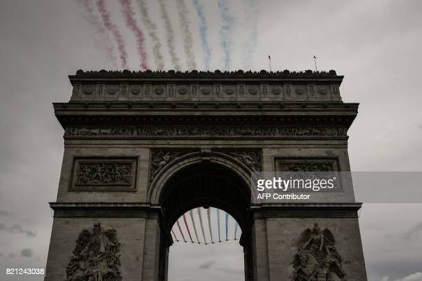 French AlphaJet of the Patrouille de France fly over the Arc de Triomphe during the 103 km twentyfirst and last stage of the 104th edition of the...