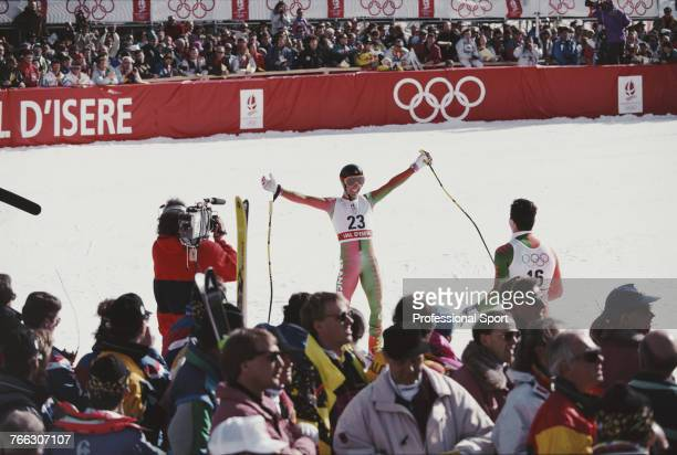 French alpine skier Franck Piccard of the France team pictured raising his arms in the air in celebration as he faces team mate Luc Alphand after...