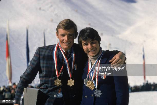 French alpine skiers JeanClaude Killy and Marielle Goitschel pose together at the World Alpine Ski Championships their various medals around their...