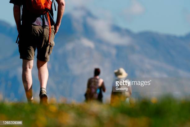 French Alps. Mont Blanc Massif. Walkers on a path in summer. Saint-Gervais. France.