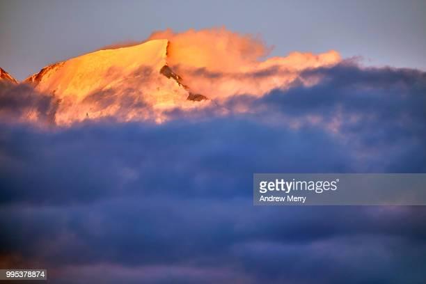 french alps mountain peak rising above clouds near mont blanc at sunset - pinnacle peak bildbanksfoton och bilder