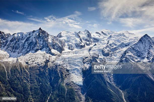 french alps mountain range with snow line. mont blanc summit, glaciers, chamonix valley and blue sky - pinnacle peak stock pictures, royalty-free photos & images