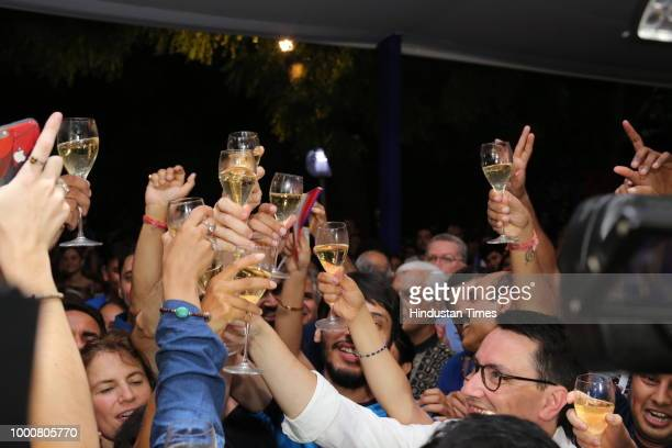 French Ambassador Alexandre Ziegler celebrate victory of France with fans during screening of Fifa World Cup final between France and Croatia at...