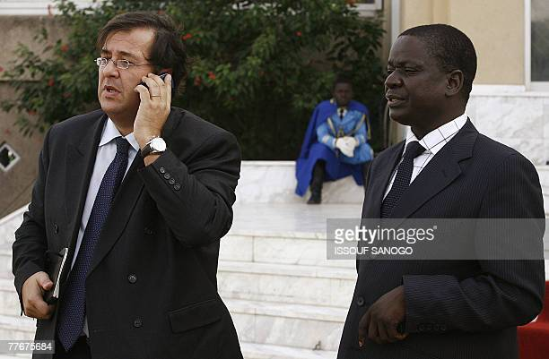 French ambassador in Chad Bruno Foncher flanked by Chadian Justice Minister Albert Pahimi Padacke gives a phone call 04 November 2007 in front of the...