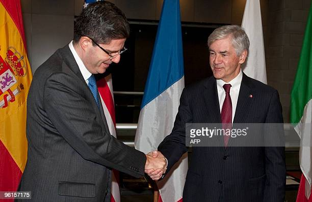 French Ambassador of Canada M Francois Delattre shaking hands with Canadian minister of foreign affairs Lawrence Cannon as they arrive for the Haiti...