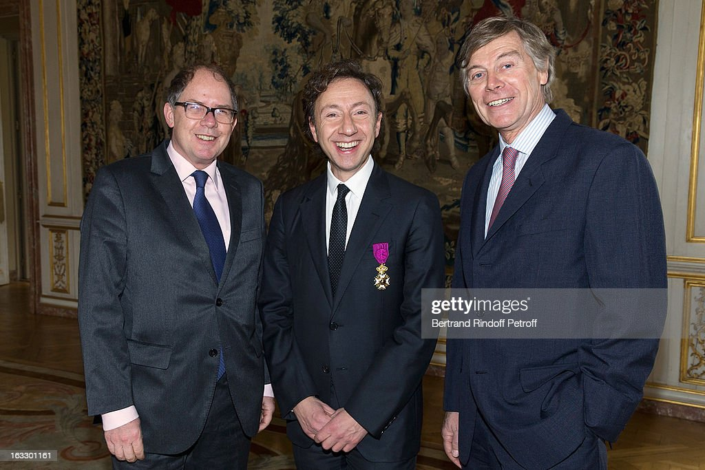 French Ambassador to Belgium Bernard Valero, French journalist and author Stephane Bern and Belgian Ambassador to France Patrick Vercauteren Drubbel pose after Bern was appointed officer in the King Leopold order during a ceremony at Palais d'Egmont on March 7, 2013 in Brussels, Belgium.