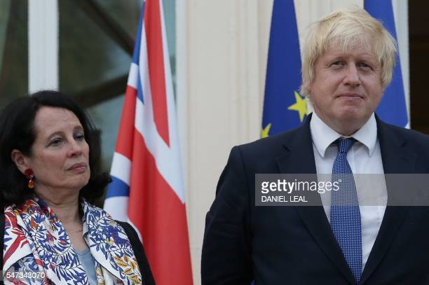 French Ambassador to Britain Sylvie Bermann listens as British Foreign Secretary Boris Johnson speaks as he attends during a reception at the French...