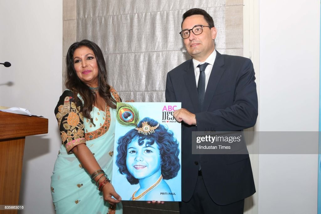 French Ambassador to India, Alexandre Ziegler, with Businesswoman Priti Paul (L) during the launch of businesswoman Priti Paul's debut book, that aims at teaching alphabet in an Indian way, at French Embassy, on August 18, 2017 in New Delhi, India. The canvases, hand-painted by Bollywood artists, are part of the book. The launch was followed by a cultural dance performance.
