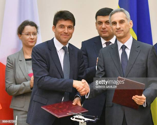 French Ambassador to Ukraine Isabelle Dumont and Prime Minister of Ukraine Volodymyr Groysman applaud as CEO of Airbus Helicopters Bruno Even and...