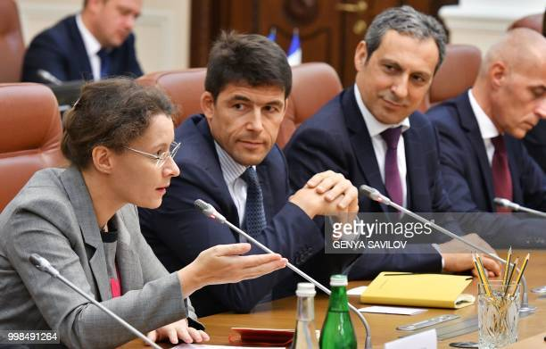 French Ambassador to Ukraine Isabelle Dumont speaks next to CEO of Airbus Helicopters Bruno Even before signing a contract in Kiev on July 14 2018...